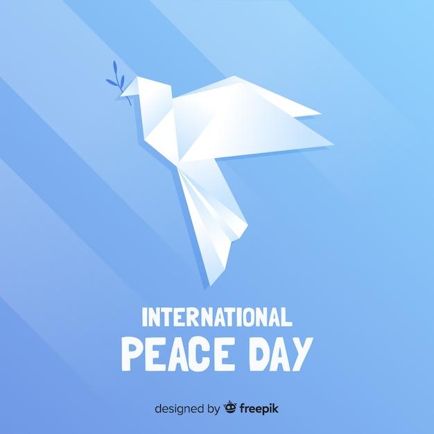 Conceito de dia da paz com pomba de origami Vetor grátis