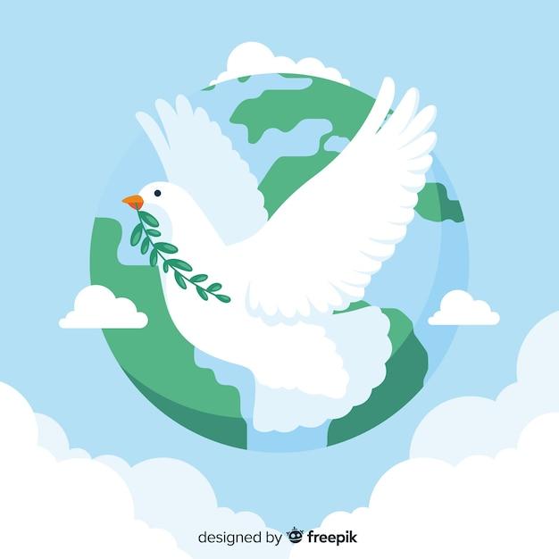Conceito de dia da paz com uma pomba Vetor grátis