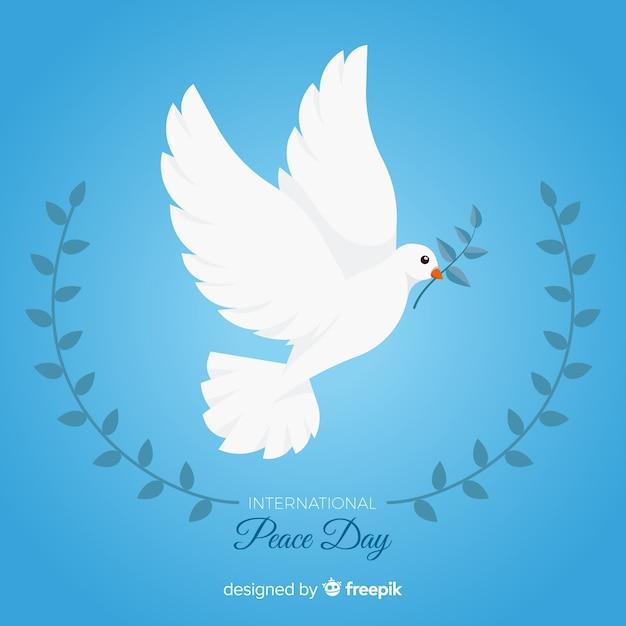 Conceito de dia internacional da paz com pomba branca Vetor grátis