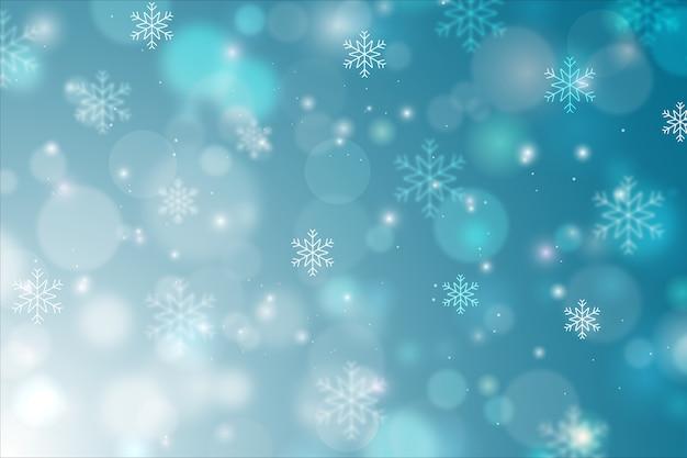 Conceito de inverno com fundo desfocado Vetor grátis