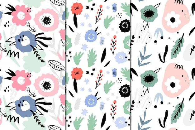 Conjunto de 3 padrões sem emenda com flores abstratas. mão desenhada, estilo doodle. Vetor Premium