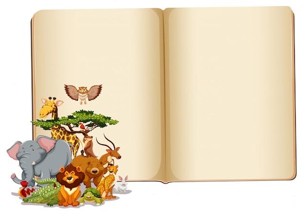 Conjunto de animais com livro em branco Vetor grátis