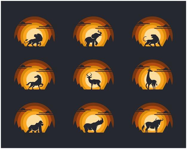 Conjunto de animais com montanha do penhasco e fundo do céu. Vetor Premium
