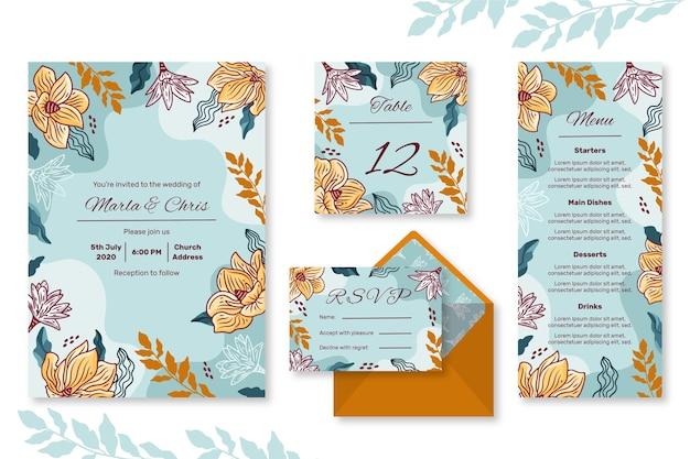 Conjunto de artigos de papelaria de casamento floral Vetor grátis