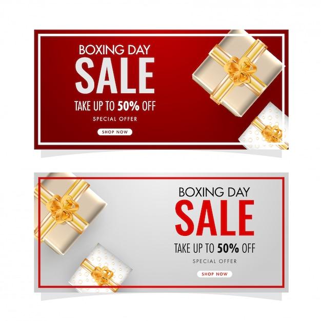 Conjunto de banner de venda de dia de boxe conjunto com 50% de desconto e vista superior das caixas de presente decoradas em Vetor Premium