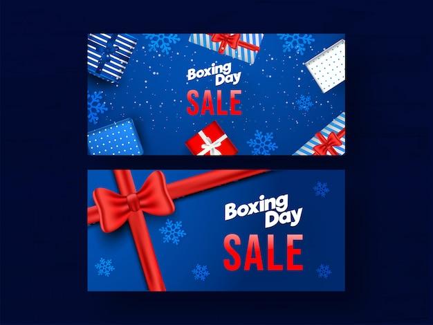Conjunto de banner de venda dia de boxe conjunto com vista superior caixas de presente e flocos de neve decorados em azul Vetor Premium