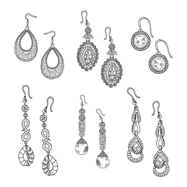 Conjunto de brincos de mão desenhada - jóias isolado no fundo branco Vetor Premium