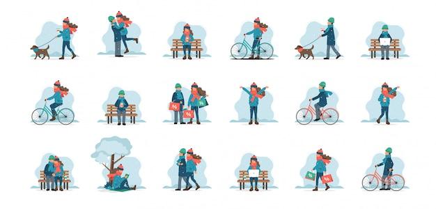 Conjunto de caracteres masculinos e femininos ao ar livre em roupas de inverno Vetor Premium