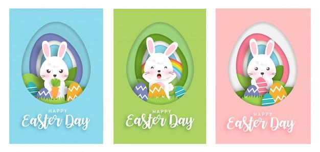 Conjunto de cartões de dia de páscoa com coelhinho fofo no estilo de corte e artesanato de papel. feliz páscoa . Vetor Premium
