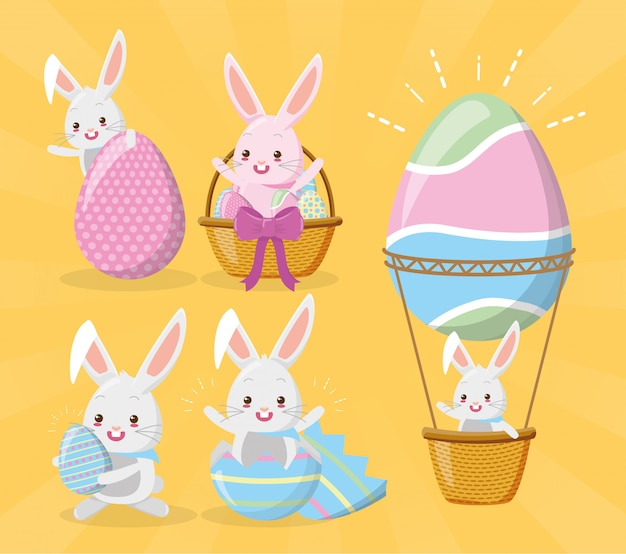 Conjunto de coelhos desejando feliz páscoa Vetor grátis