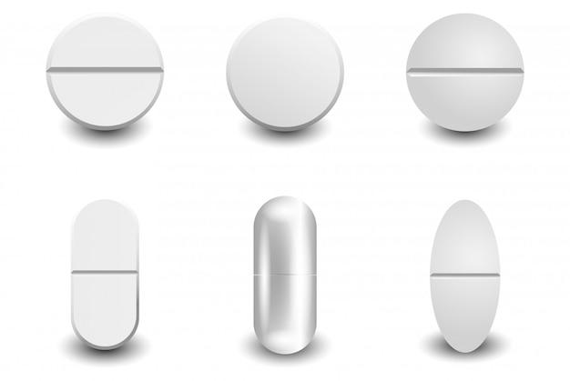 Conjunto de comprimidos brancos realistas de vetor diferente isolado Vetor Premium
