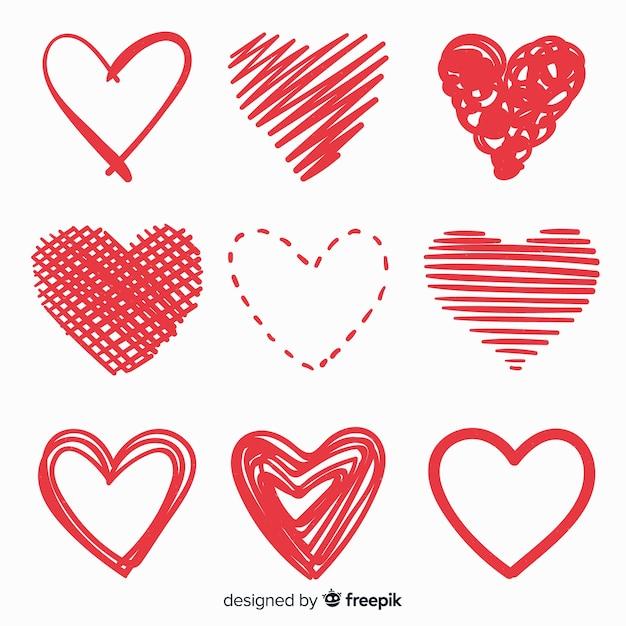 Conjunto de coração desenhado de mão Vetor grátis