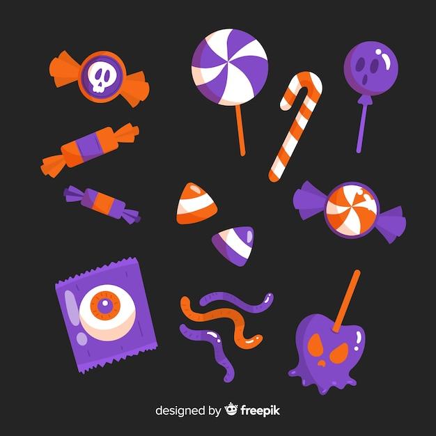 Conjunto de design plano de doces de halloween Vetor grátis
