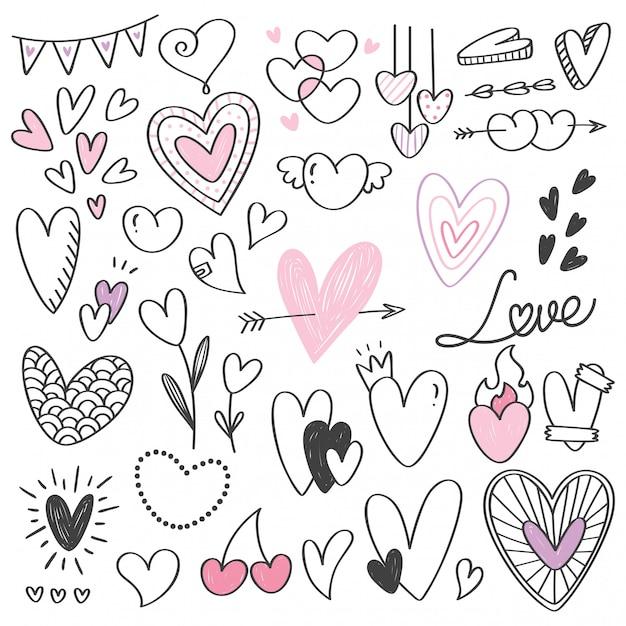 Conjunto de doodle de forma de coração isolado no branco Vetor Premium