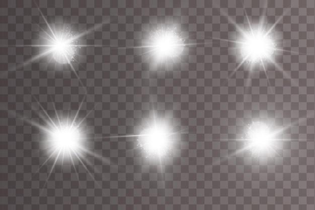 Conjunto de efeitos de luz luminosa isolado. lens flares, estrelas e coleção de faíscas. Vetor Premium