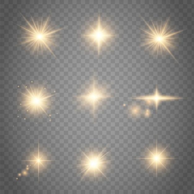 Conjunto de efeitos de luzes brilhantes dourados existentes na transparente Vetor Premium