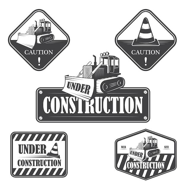 Conjunto de emblemas em construção, etiquetas e elementos de design Vetor grátis
