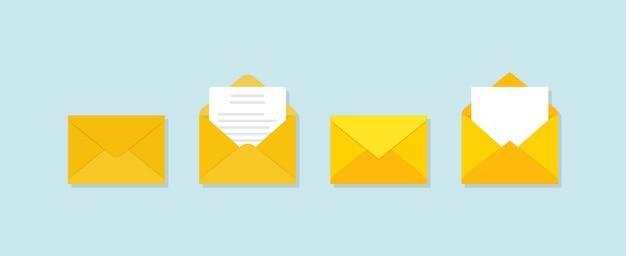 Conjunto de envelopes amarelos em diferentes pontos de vista sobre fundo azul. Vetor Premium