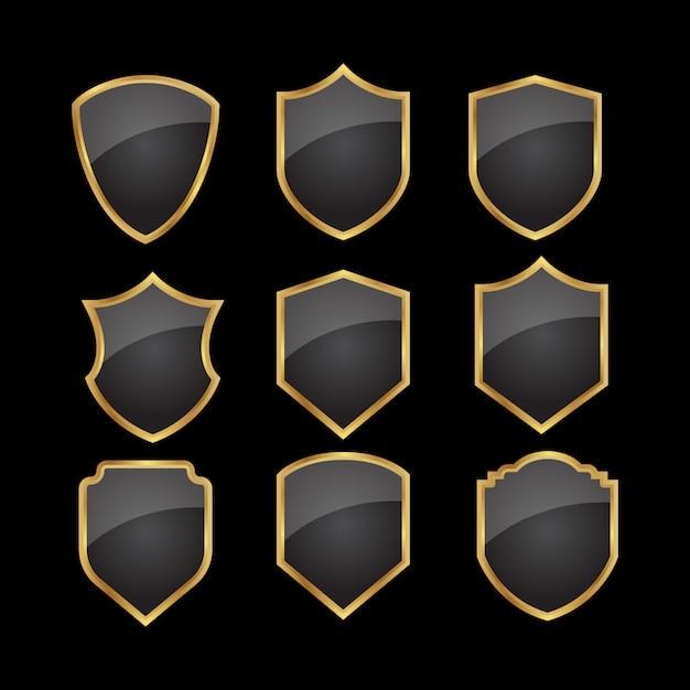 Conjunto de escudo de ouro preto Vetor Premium