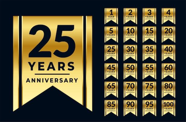 Conjunto de etiquetas ou emblemas dourados de aniversário estilo fita Vetor grátis
