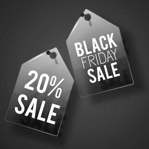 Conjunto de etiquetas pretas de venda pendurada na parede cinza escuro com manchetes em cada uma Vetor grátis