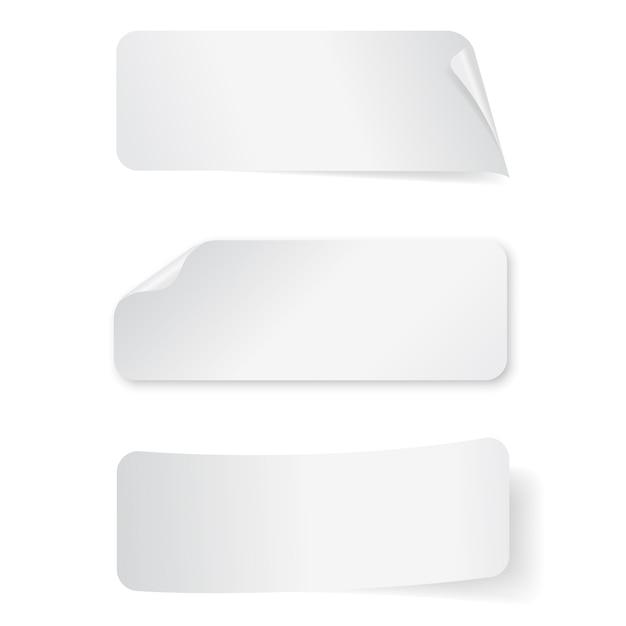 Conjunto de etiquetas retangulares de papel vazio no fundo branco. Vetor Premium