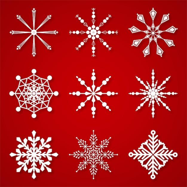 Conjunto de flocos de neve de inverno bonito elementos Vetor grátis
