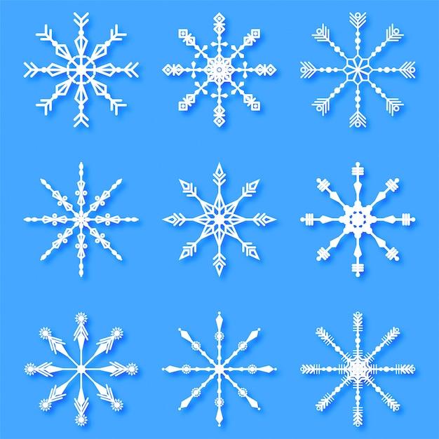 Conjunto de flocos de neve decorativos criativos de feliz natal Vetor grátis