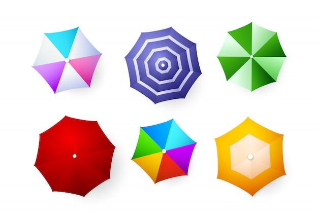 Conjunto de guarda-chuvas de praia Vetor grátis