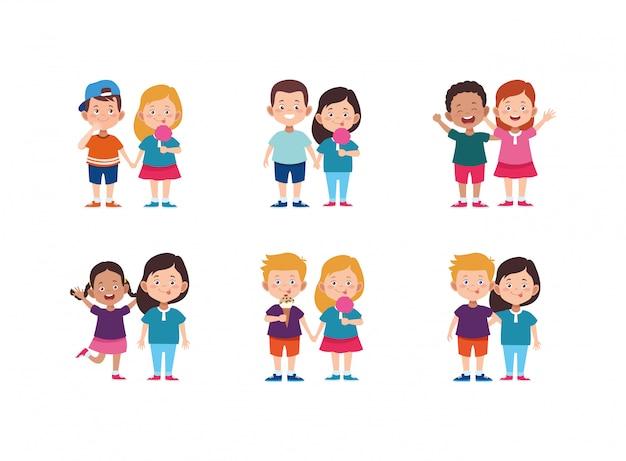 Conjunto de ícones de casais de crianças felizes dos desenhos animados Vetor Premium