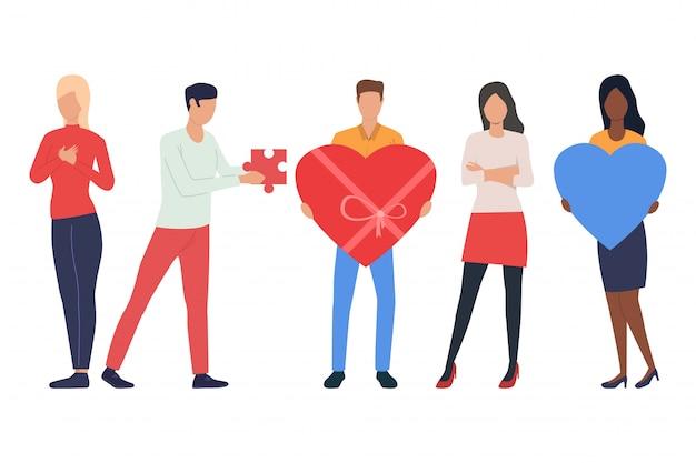 Conjunto de jovens apaixonados. homens e mulheres segurando corações Vetor grátis