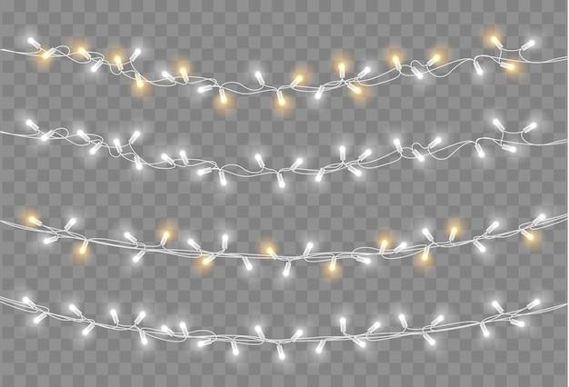 Conjunto de luzes de natal. ano novo vetor decorar guirlanda com lâmpadas brilhantes. Vetor Premium