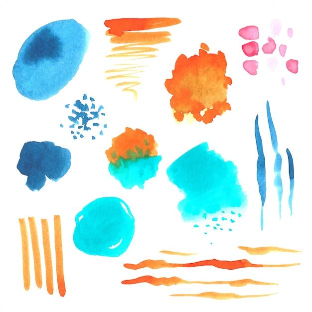 Conjunto de manchas de aquarela de pintados à mão Vetor Premium