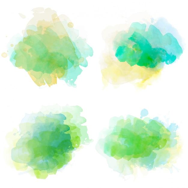 Conjunto de manchas de aquarela isolado no fundo branco Vetor Premium