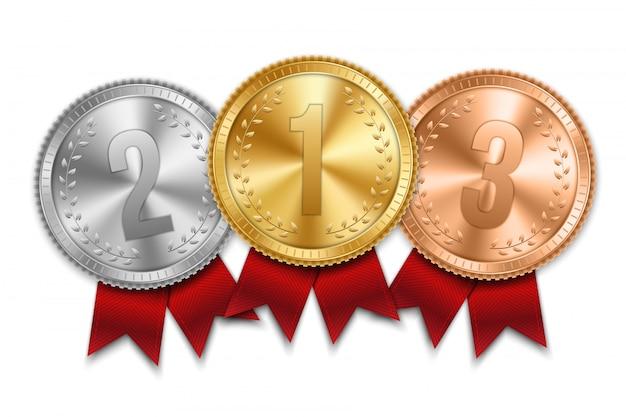 Conjunto de medalha de ouro, prata e bronze com fita. Vetor Premium