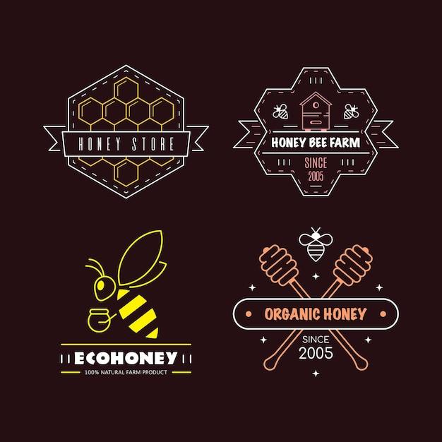 Conjunto de modelos de design de logotipo de contorno. rótulos de mel orgânico e ecológico isolados no fundo preto. empresa de produção de mel, pacote de mel. Vetor Premium