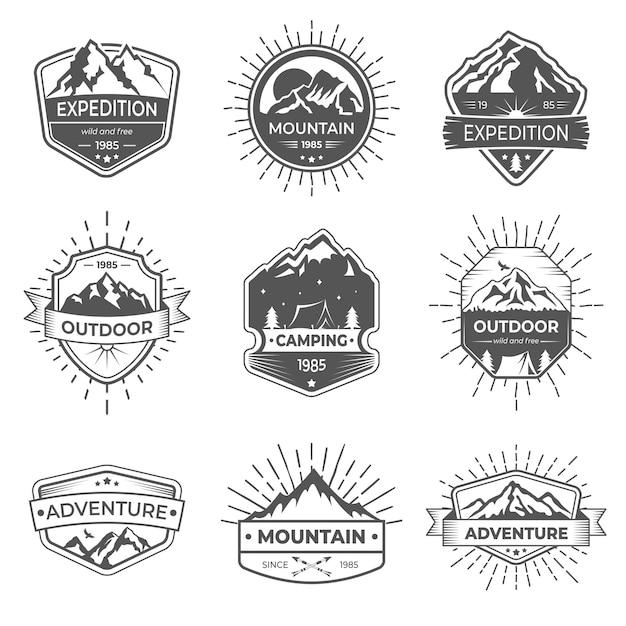 Conjunto de nove montanha de vetor e logotipo de aventuras ao ar livre. Vetor Premium
