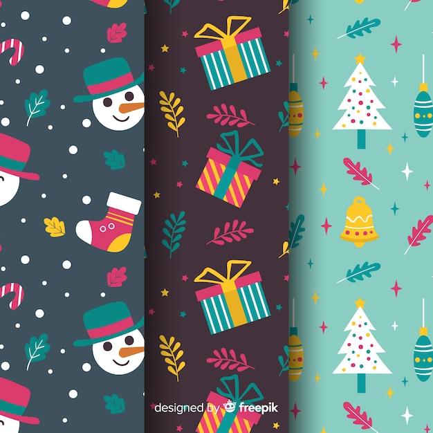 Conjunto de padrão de natal em design plano Vetor grátis