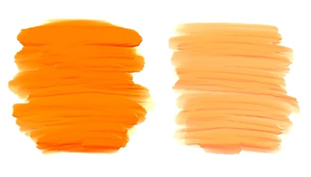 Conjunto de pinceladas laranja abstratas Vetor grátis
