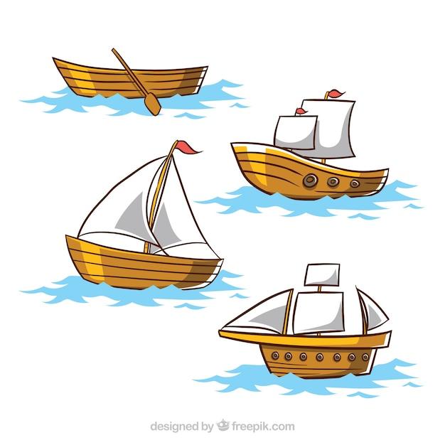 Conjunto de quatro barcos de madeira Vetor Premium