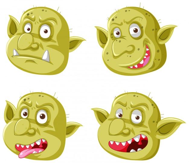 Conjunto de rosto amarelo goblin ou troll em diferentes expressões em estilo cartoon, isolado Vetor grátis