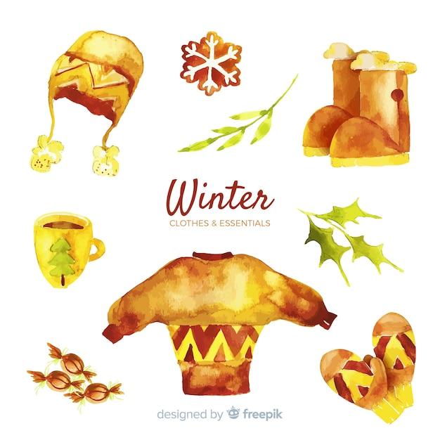 Conjunto de roupas e itens essenciais de inverno Vetor grátis