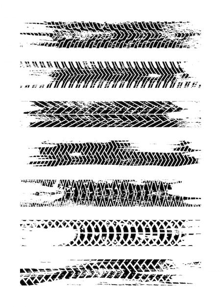Conjunto de silhueta de faixa de pneu preto. trilha do pneu de grunge isolada. faixa de pneu com manchas de tinta. splatter de estrada de pista de pneu Vetor Premium