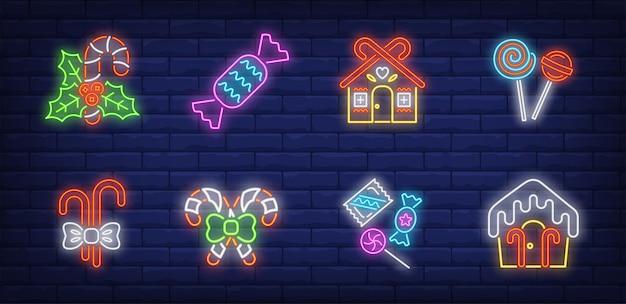 Conjunto de símbolos de doces de natal em estilo neon Vetor grátis