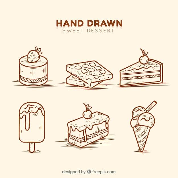 Conjunto de sobremesas doces em estilo desenhado a mão Vetor Premium