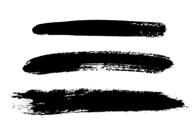 Conjunto de traçado de pincel mão desenhada, manchas. conjunto de elementos de design monocromático. Vetor Premium