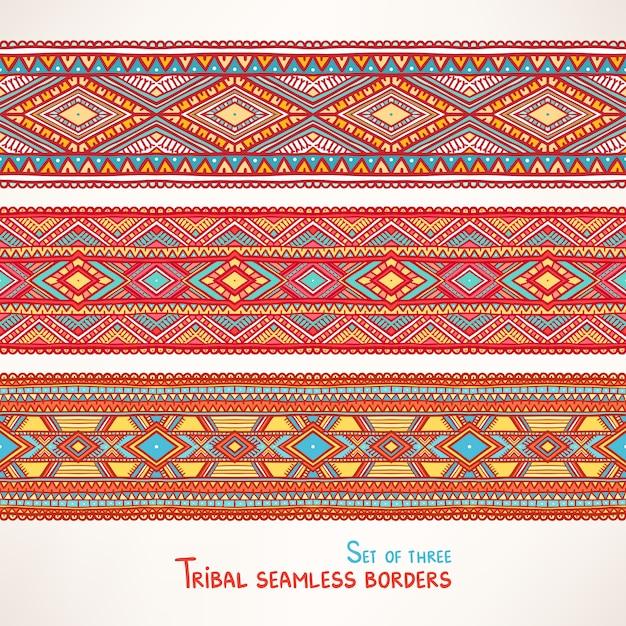 Conjunto de três lindas fronteiras tribais sem costura com triângulos e losangos Vetor Premium