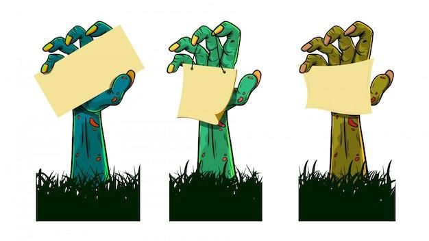 Conjunto de zumbis mãos segurando um papel em branco Vetor Premium