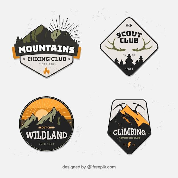 Conjunto moderno de emblemas de montanha Vetor grátis