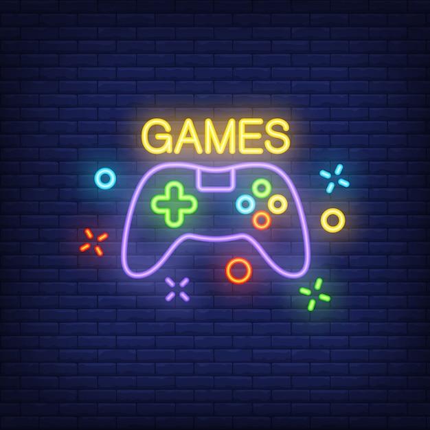 Console com letras de jogos. sinal de néon no fundo do tijolo. Vetor grátis